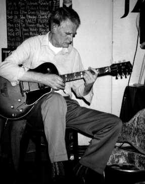 Derek Bailey playing the guitar