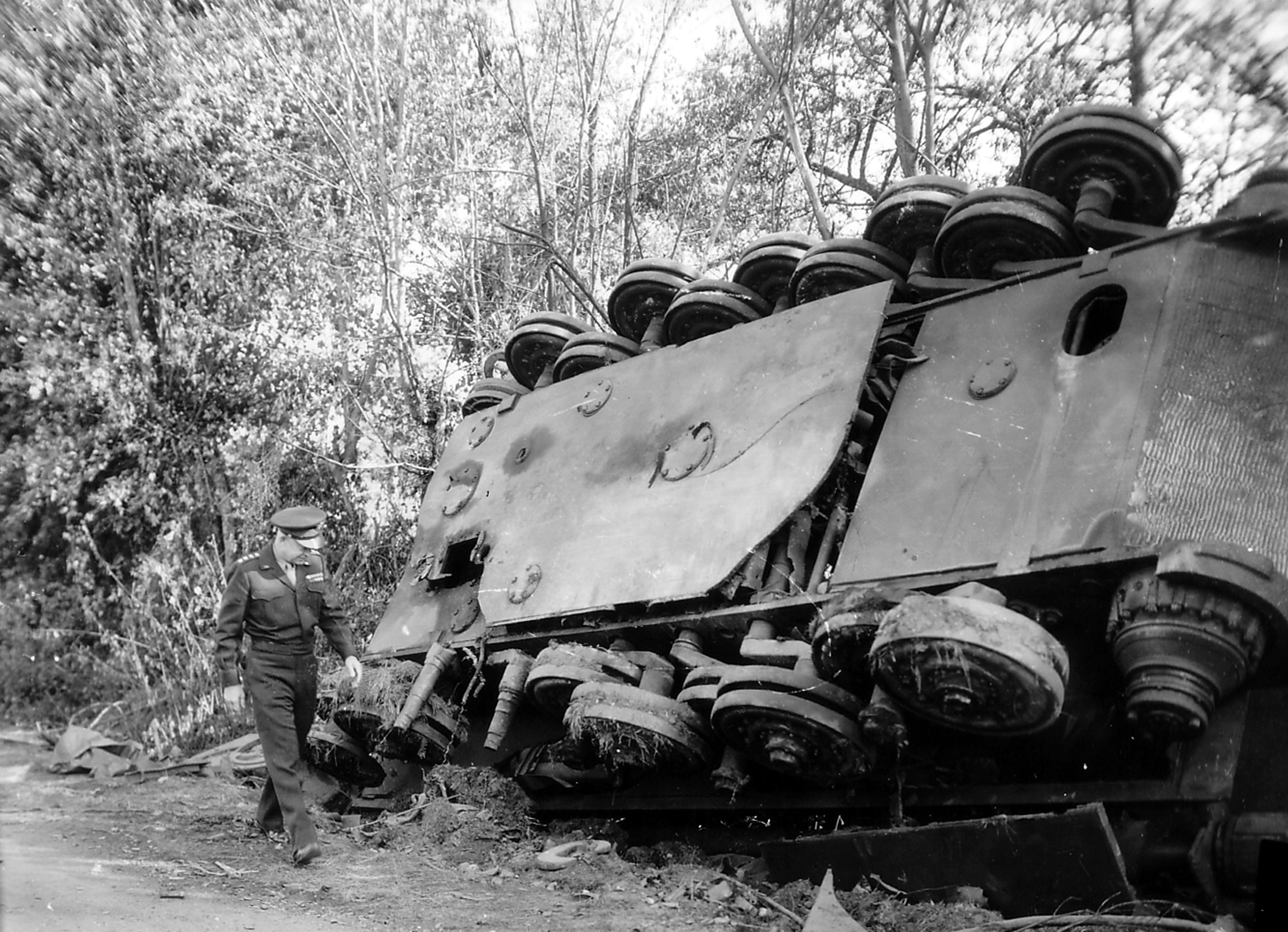 """Ike"" taking a look at an overturned Tiger"