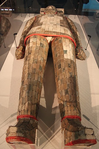A Chinese Eastern Han (25-220 AD) burial suit with silver thread connecting the pieces of jade covering the deceased.