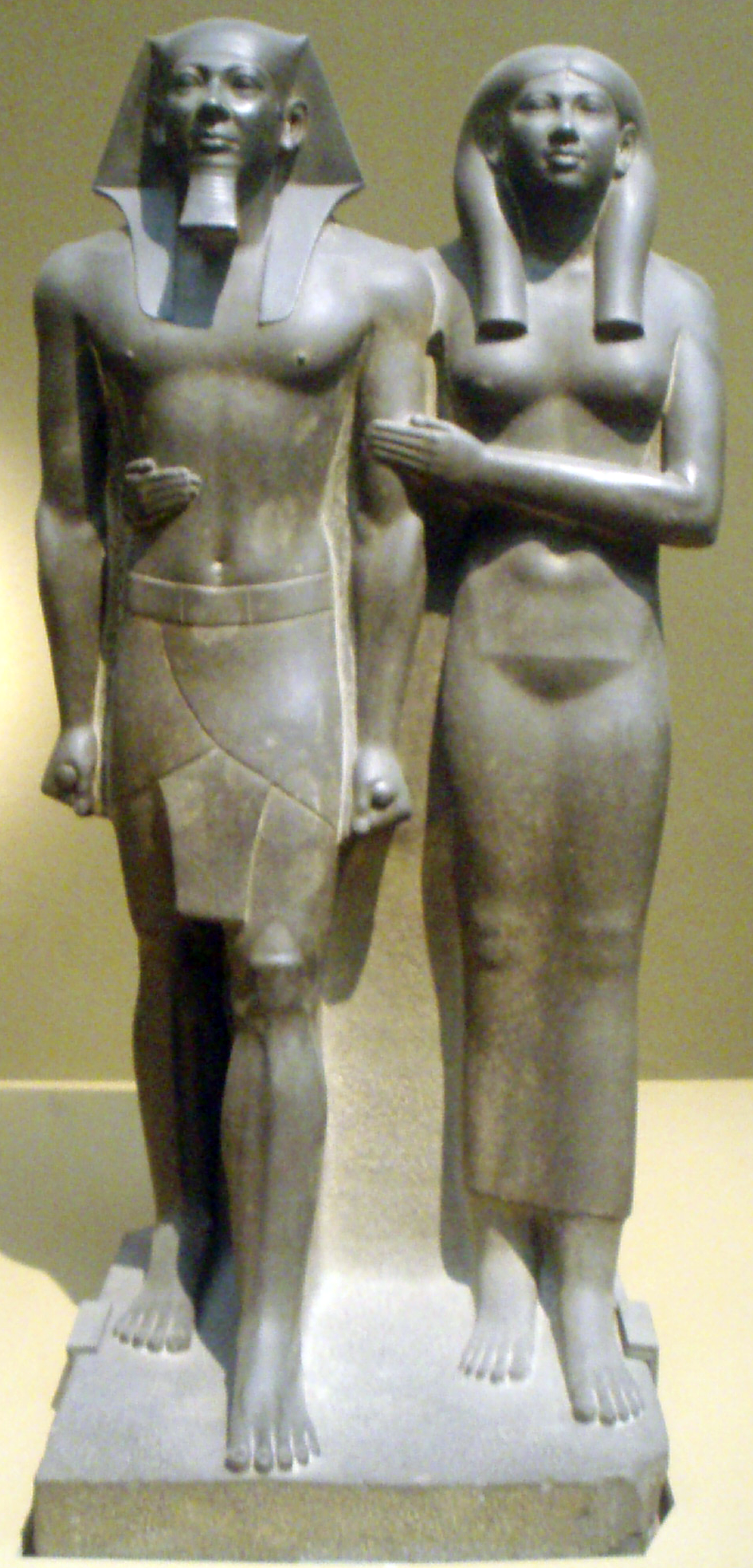 a description of the group of sculpture of king menkaure and his queen Males in keeping with osiris as the first king of egypt and his sister isis as  queen hatshepsut: daughter of amun, pharaoh of  of king menkaure,.