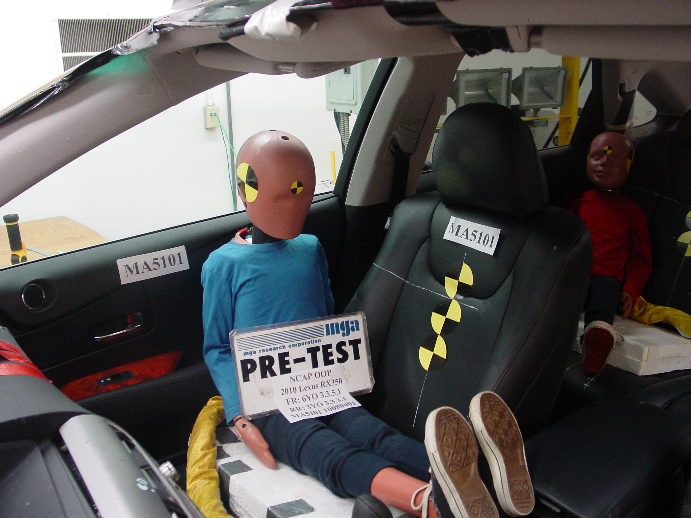 6 Year Old And 3 Hybrid Iii Dummies Sitting In A Lexus Rx350 Prior To An Static Side Airbag Deployment Test
