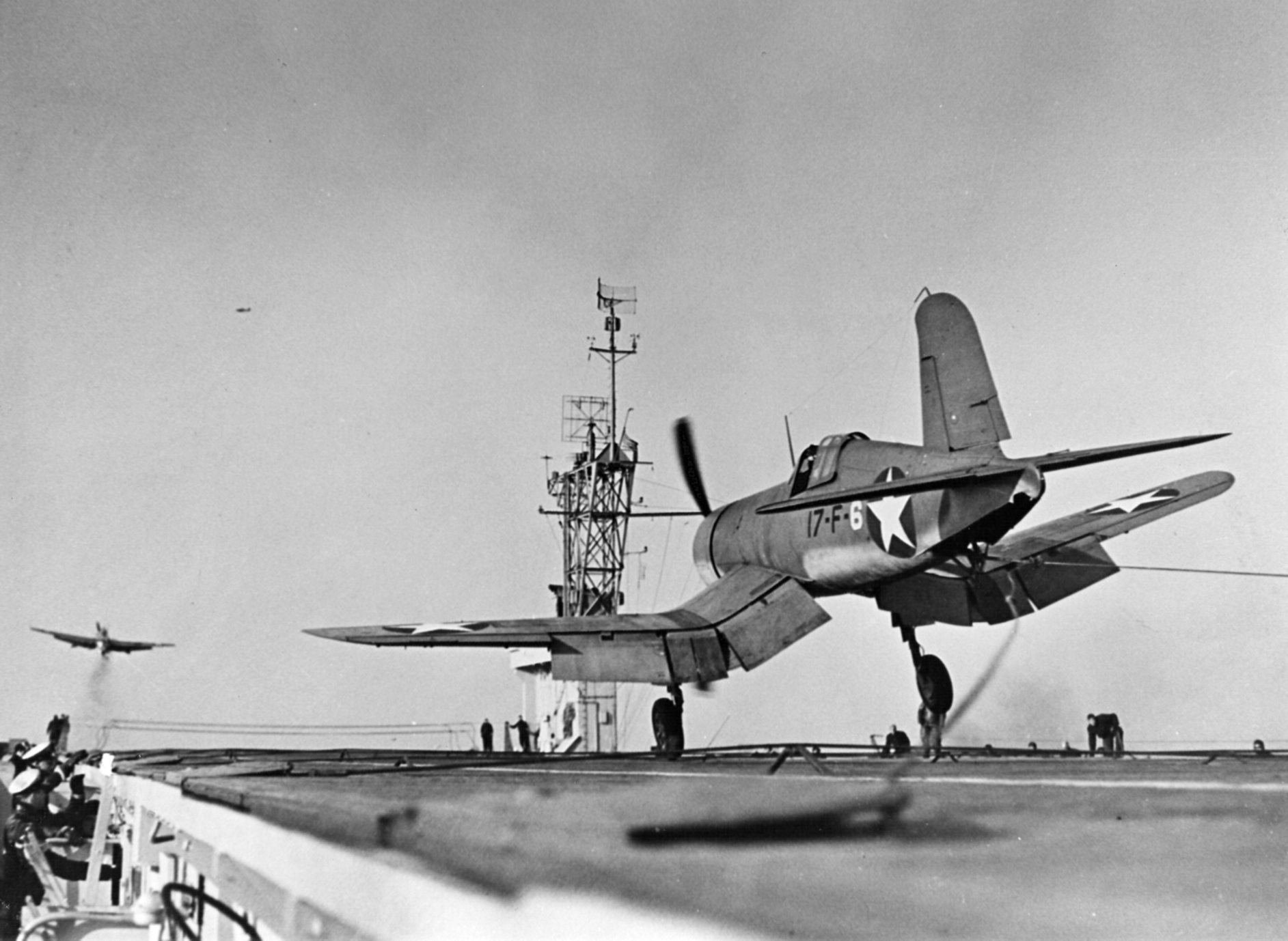 http://upload.wikimedia.org/wikipedia/commons/3/3a/F4U-1_VF-17_landing_on_USS_Charger_(CVE-30)_1943.jpeg