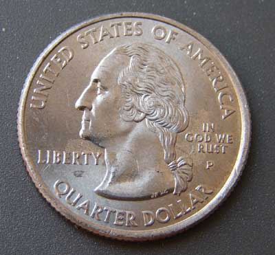 "Coin with partially rubbed off ""In God We Trust"" motto InGodWeRust.jpg"