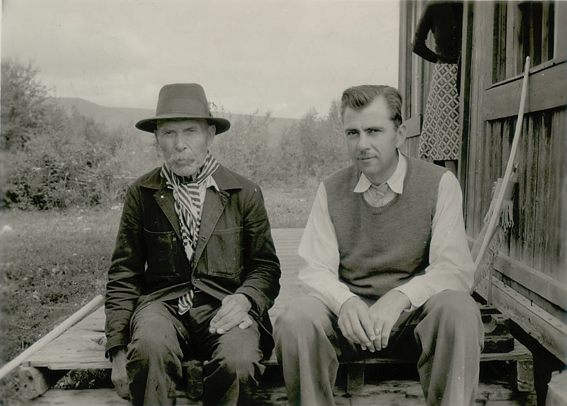 Unidentified Native Man (Carrier Indian) (possibly Steward's informant, Chief Louis Billy Prince) and Julian Steward (1902–1972) Outside Wood Building, 1940