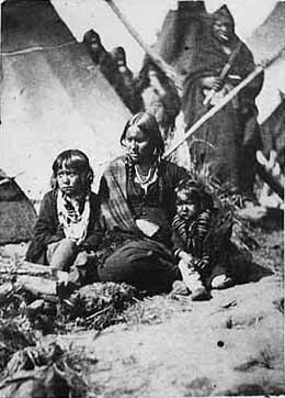Little Crow's wife and two children at Fort Snelling prison compound, 1864
