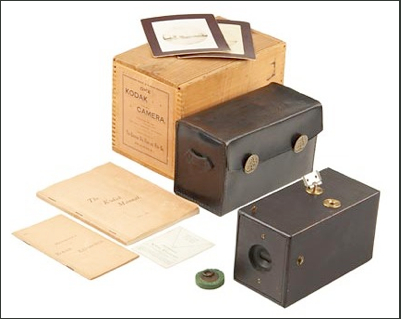 An original Kodak camera, complete with box, camera, case, felt lens plug, manual, memorandum and viewfinder card One Kodak Camera.jpg