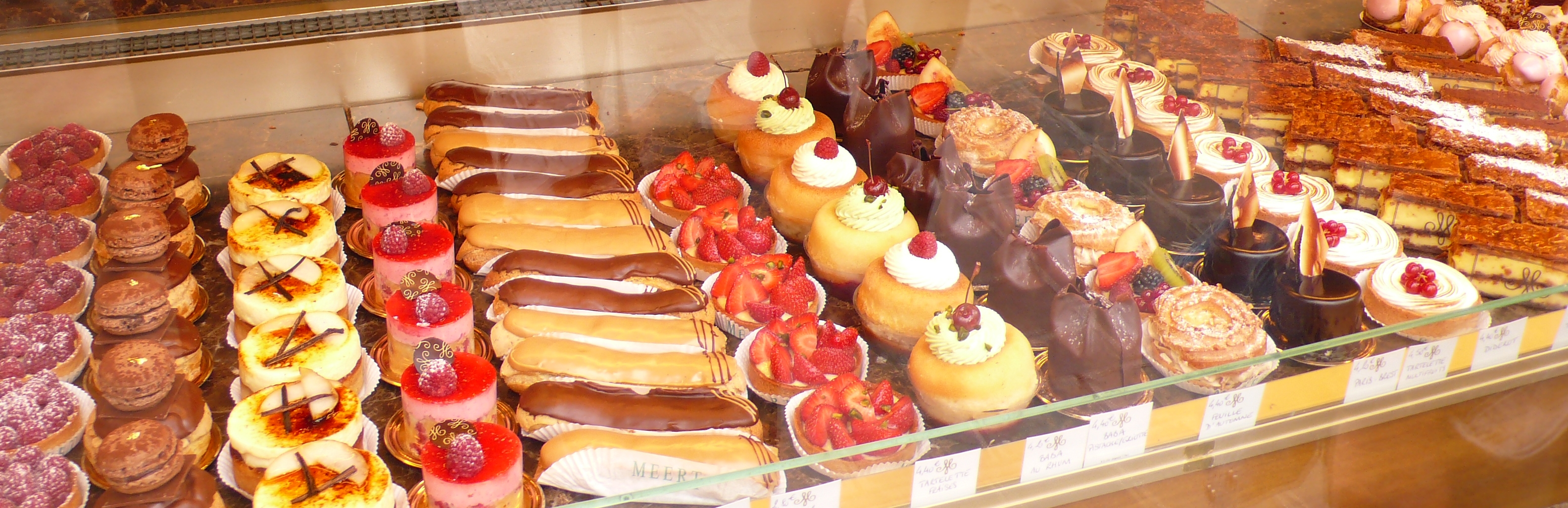 An assortment of pastries and cakes in a pâtisserie