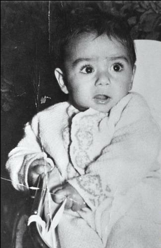 Путинский фэн-клаб - Страница 29 Saddam_in_childhood