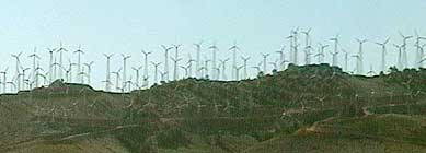 Numerous small and fast turning wind turbines at Tehachapi Pass. (U.S.) Today's turbines are larger and spaced farther apart, as that has proven to be a more cost-effective approach.
