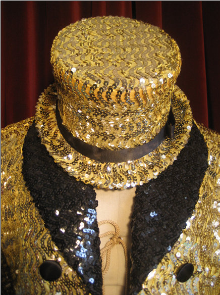 A replica costume based on the film's gold sequined swallow-tail coat worn by Little Nell, recreated by fan Mina Credeur of Houston, Texas. Columbia top hat and tux.jpg
