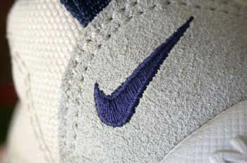 external image Nike_swoosh_on_the_tongue_of_a_shoe_%28blue_on_white%29.jpg