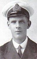 A head and shoulders portrait of a young man in naval military uniform. He is wearing a cap and has an oval shaped face.