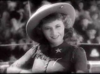 http://upload.wikimedia.org/wikipedia/commons/3/3c/Barbara_Stanwyck_in_Annie_Oakley_trailer.jpg