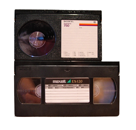 Size comparison between a Betamax cassette (top) and a VHS cassette (bottom).