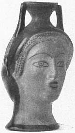 EB1911 Ceramics Fig. 57.—VASE OF 5th Cent. B.C., MODELLED IN FORM OF HEAD.jpg