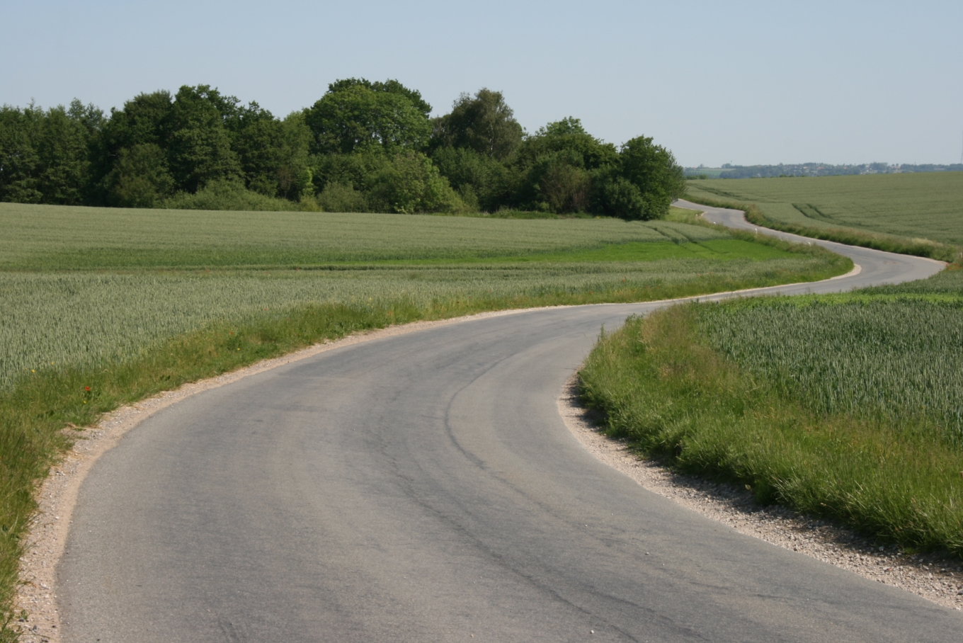 Photo of winding country road: Sten Porse, obtained from WikiMedia Commons under the terms of  Creative Commons Share-Alike 3.0 Unported license