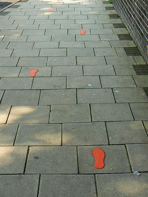 File:Orange footprints on the footpath, Princes Street