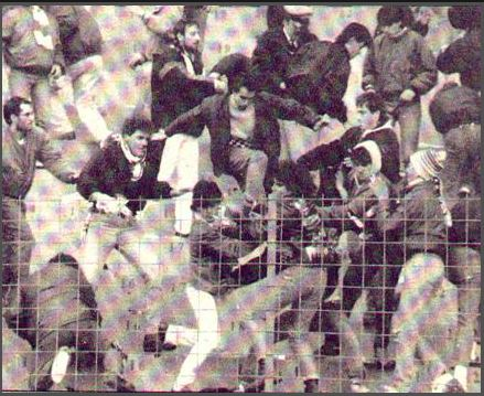 "Hooligans of ""GATE 13"" Panathinaiko's attacking supporters of ""GATE 4"" Paok and punched in field of Leoforos Alexandras stadium. Panathinaikos-paok 1989.jpg"