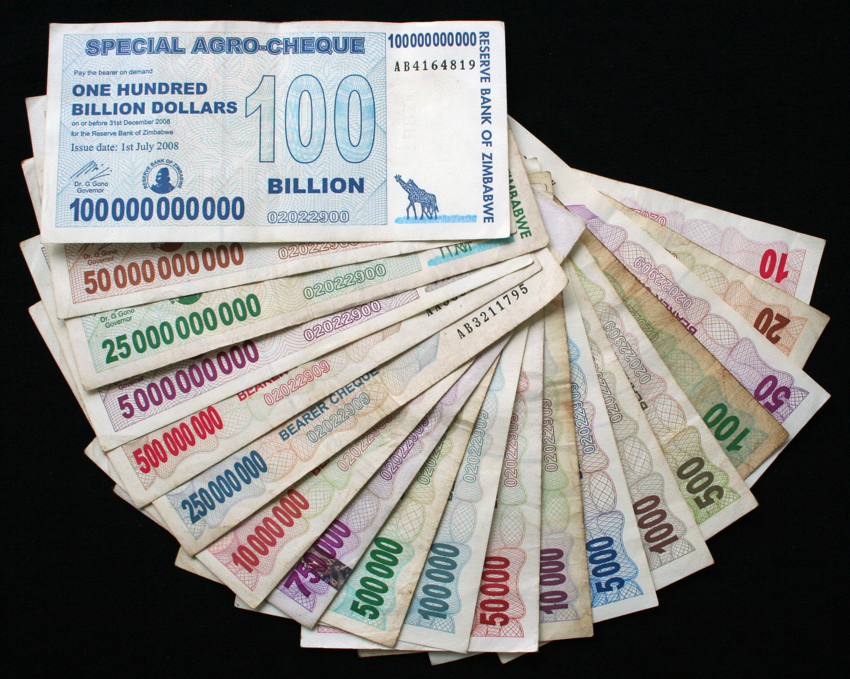 Zimbabwe dollar bills from $10 to $100,000,000,000.