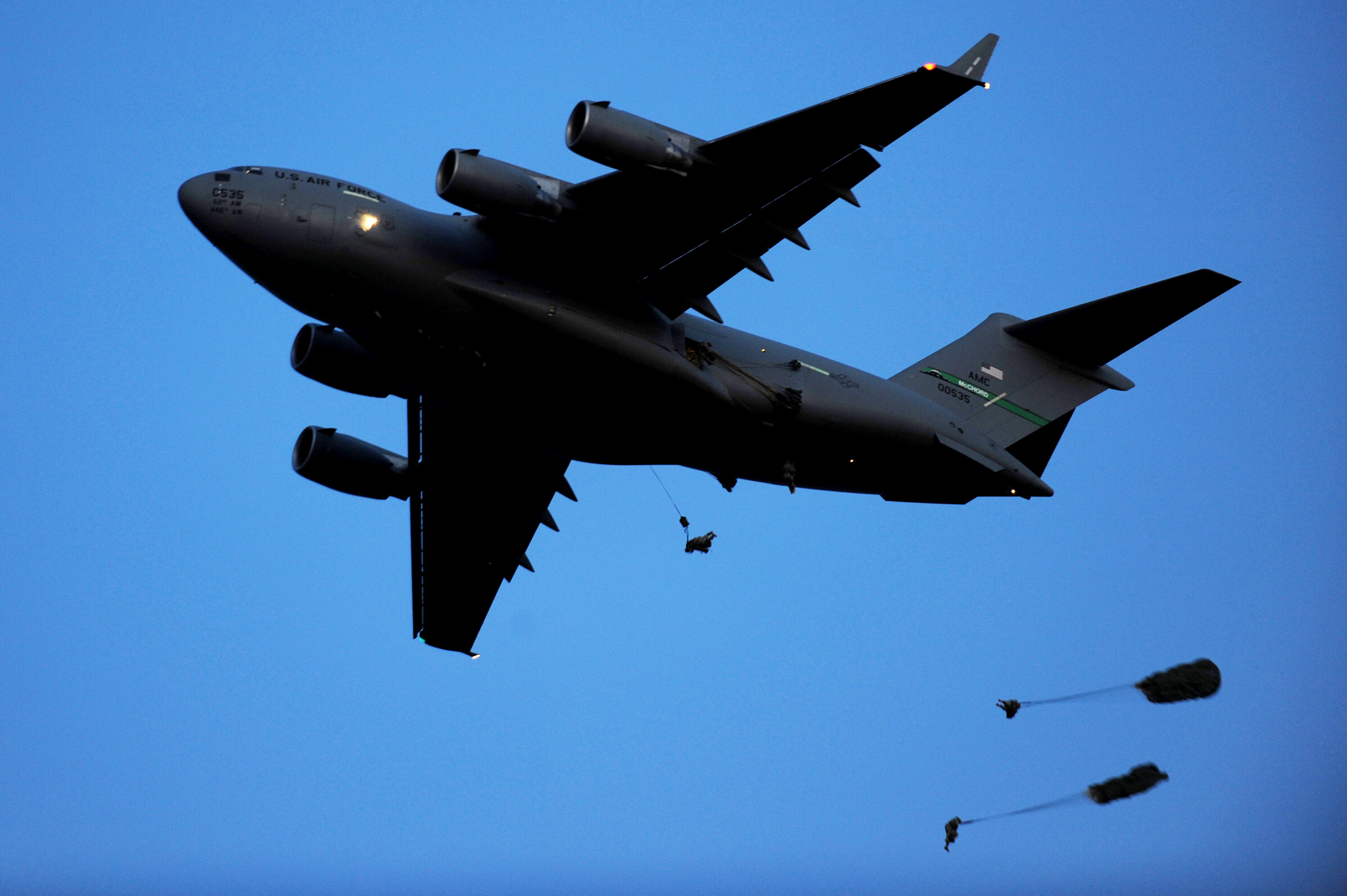Two paratroopers dropping from a C-17 during an exercise