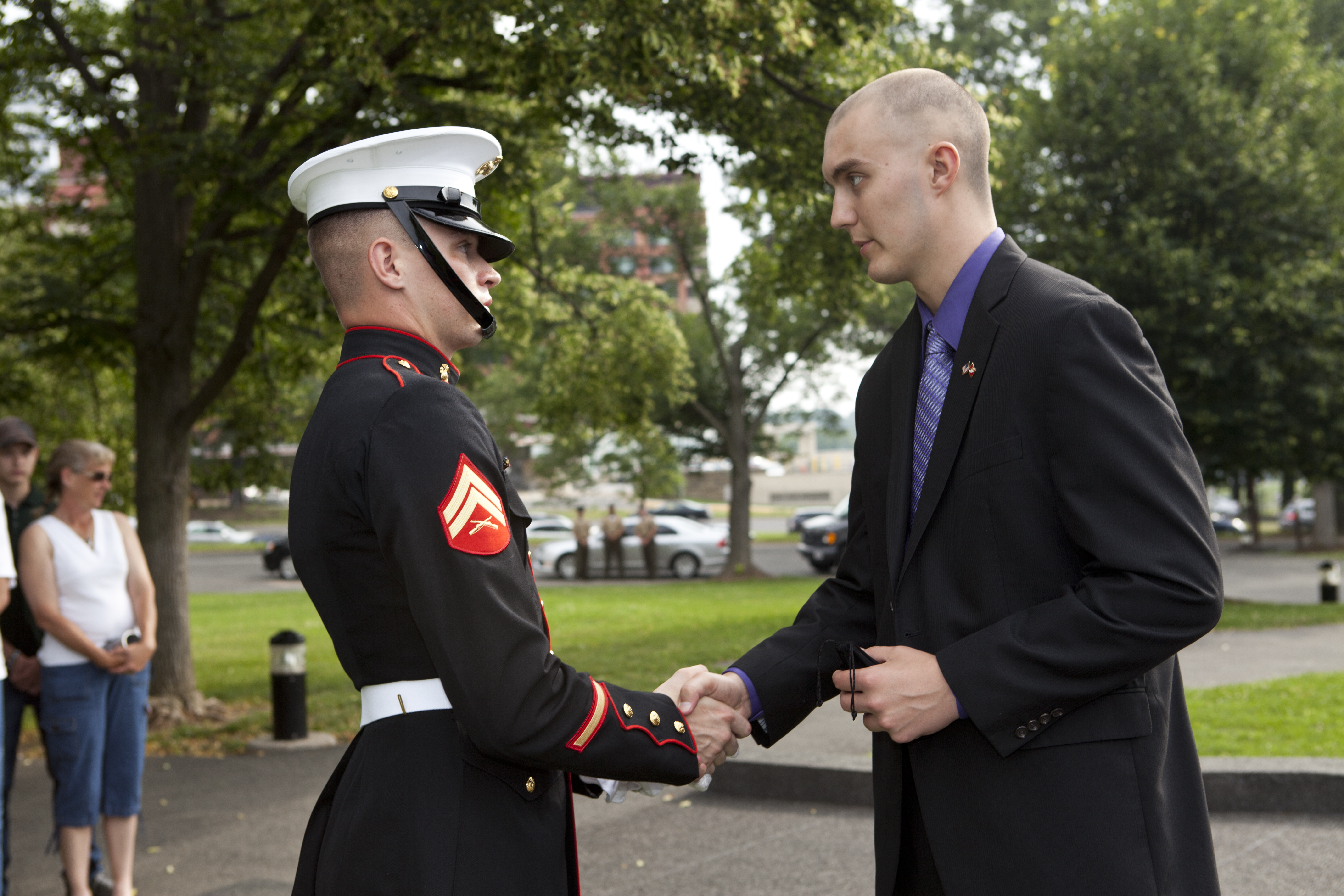 File:A U.S. Marine corporal, left, greets honorary Marine Daran ...