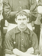 A black-and-white photograph of Abraham Foxall, posing for a team photo.