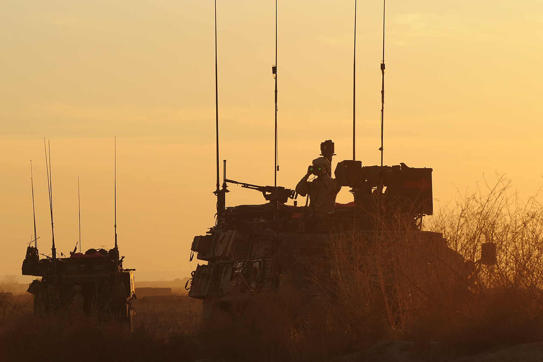At sunset a convoy of Canadian Light Armored Vehicles over-watches the area near Khadan Village, Afghanistan, Jan. 25