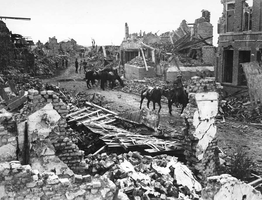 Ruined La Bassee, France, during World War I. Parts of the houses are still standing and the road in the middle of the rubble is still visible. Cavalrymen, motorised vehicles and soldiers are all present carrying out different duties.This photograph was taken sometime after 1915. La Bassee is best known for the battle which took place there in October-November 1914. [Original reads: 'OFFICIAL PHOTOGRAPH TAKEN ON THE BRITISH WESTERN FRONT IN FRANCE - General view of La Bassee.'] http://digital.nls.uk/74545914