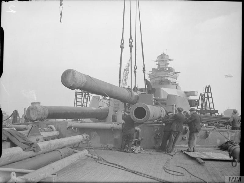 Installing_16_inch_gun_on_HMS_Rodney_at_Birkenhead_Feb_1942_IWM_A_7691.jpg
