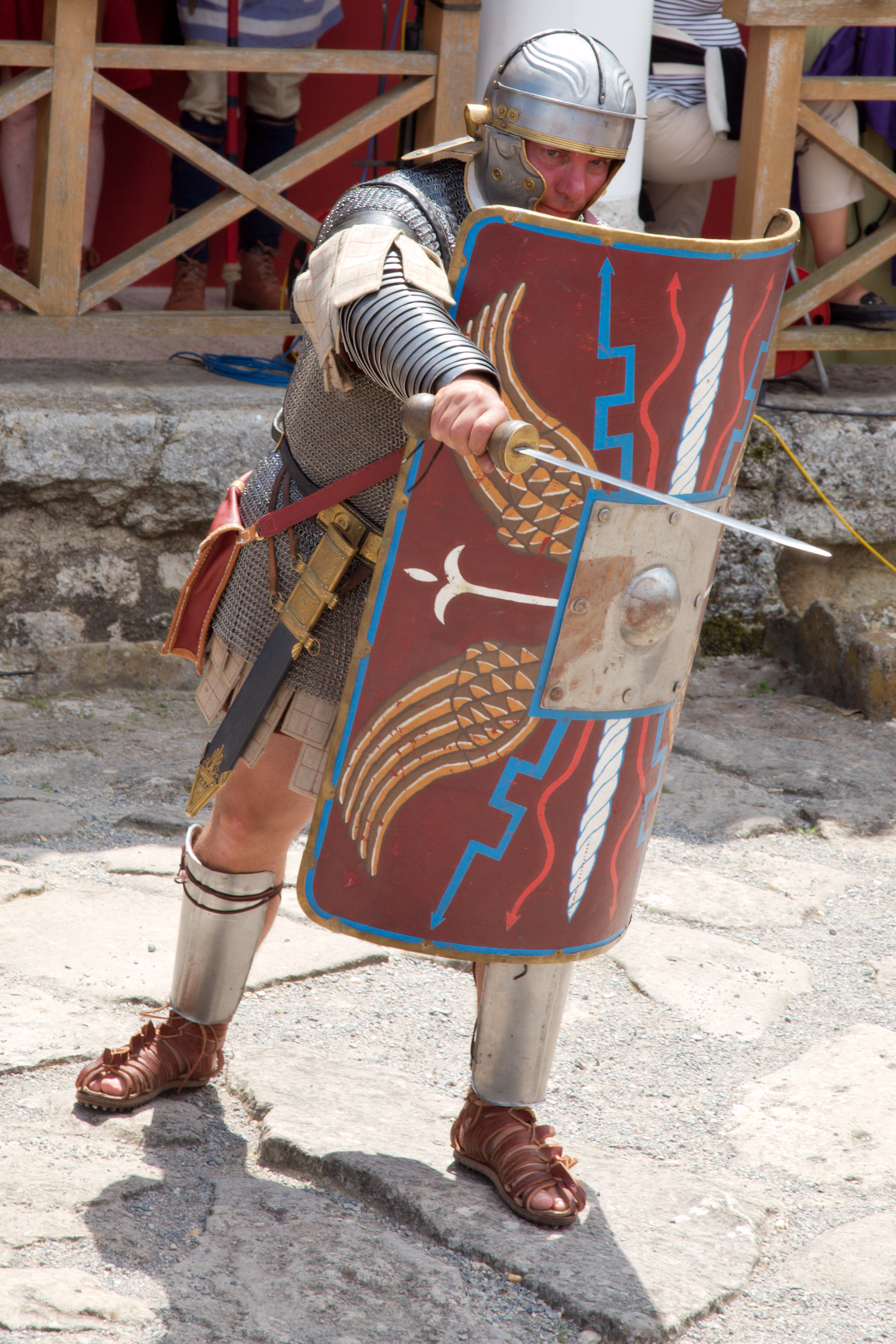 A Roman centurion with scutum raised and stabbing with a gladius