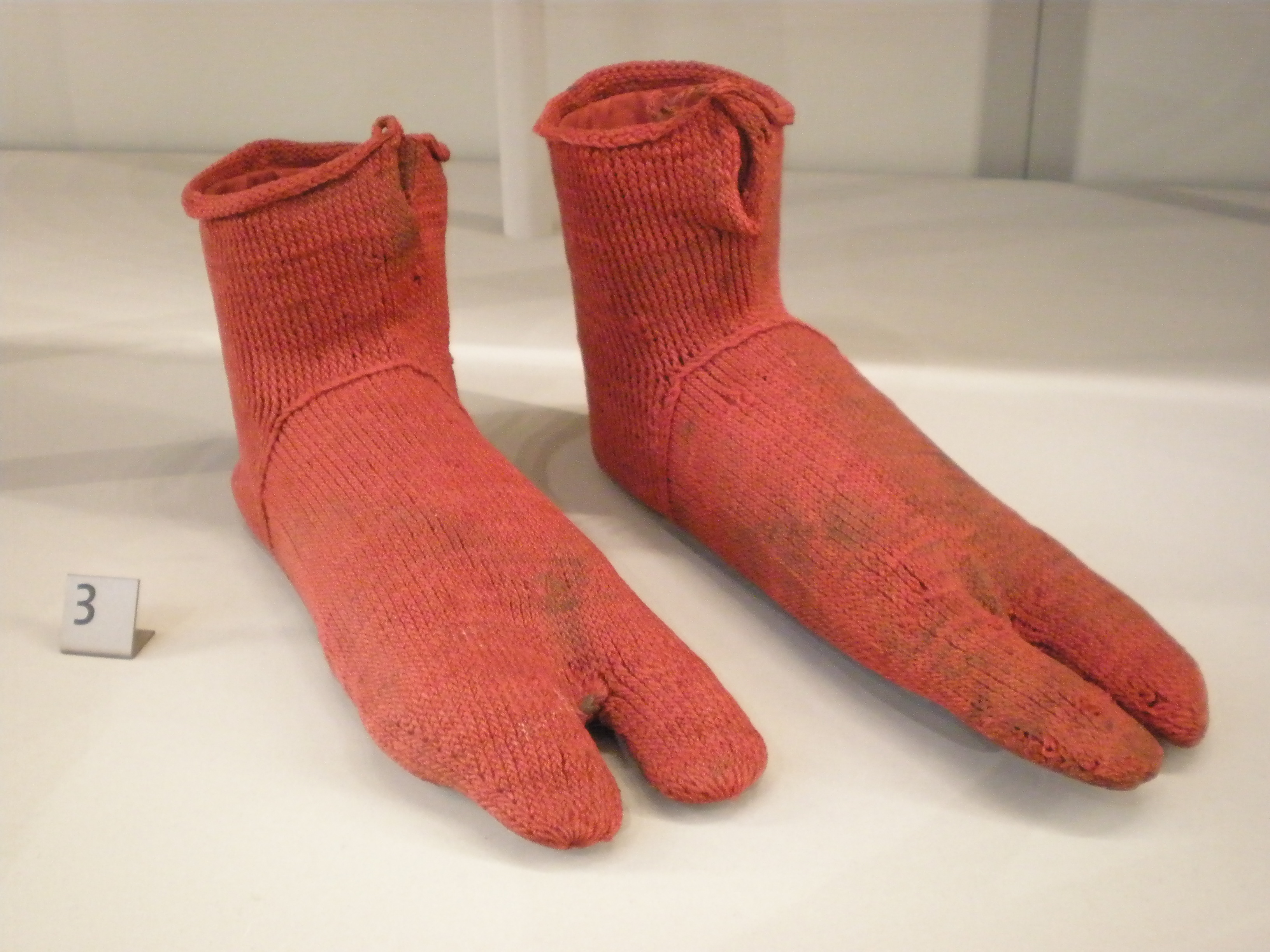 6c947f83c9308 The earliest known surviving pair of socks, created by naalbinding. Dating  from 300–500, these were excavated from Oxyrhynchus on the Nile in Egypt.
