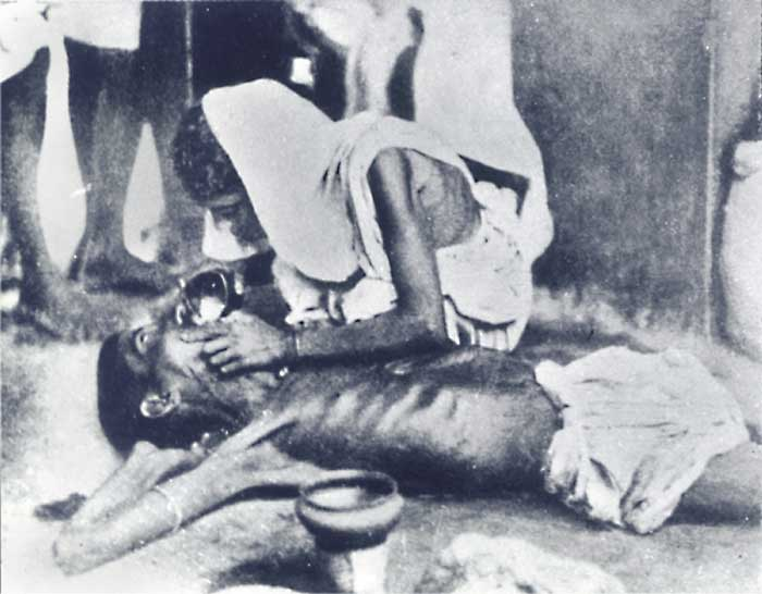 Bengal famine 1943 – A worried woman.jpg
