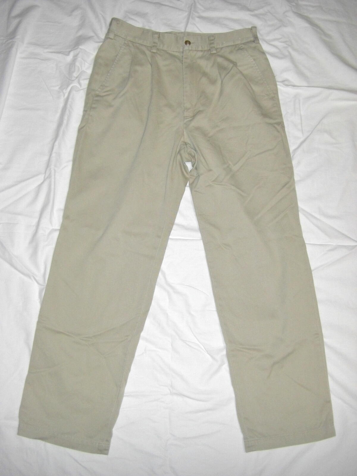 Product Features Flat-front chino pant with slanted front and rear welted pockets.