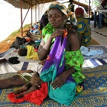 A rural mother tends to her malnourished infant at the Maradi MSF aid centre, during the 2005–2006 Niger food crisis. While the Maradi Region is the breadbasket of Niger, the 20th century saw three severe Sahel droughts which brought dramatic food insecurity to even the most fertile regions of Niger.