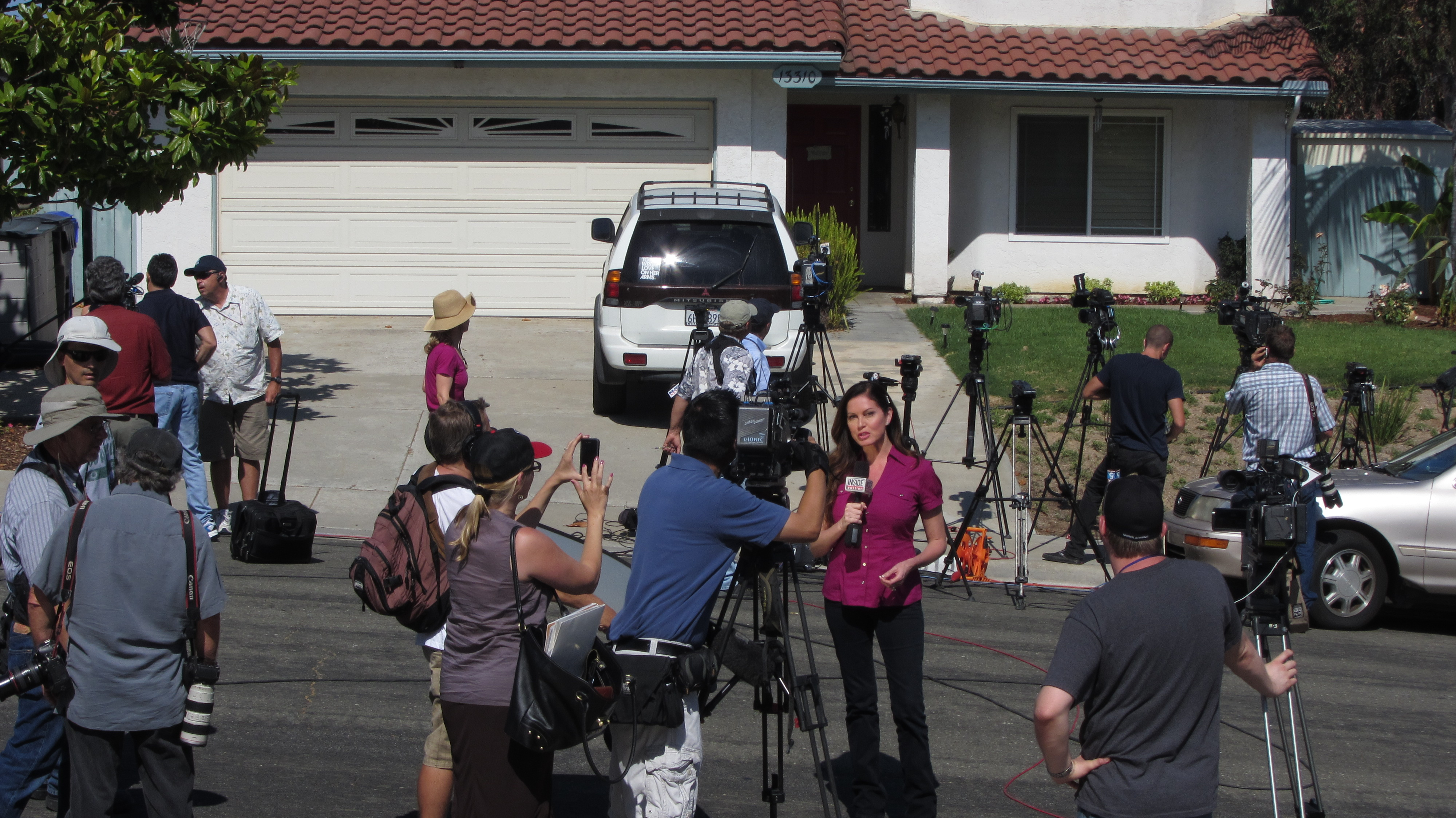 filenews reporters gather at home of james holmess