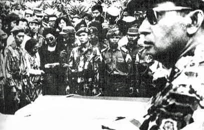 General Suharto of Indonesia attending funeral of five generals slain in 30 September movement, 2 October 1965 Suharto at funeral.jpg