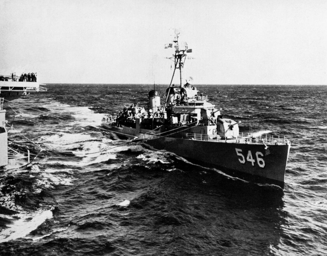 USS Brown (DD-546) being refueled by USS Hornet (CVA-12), in 1958