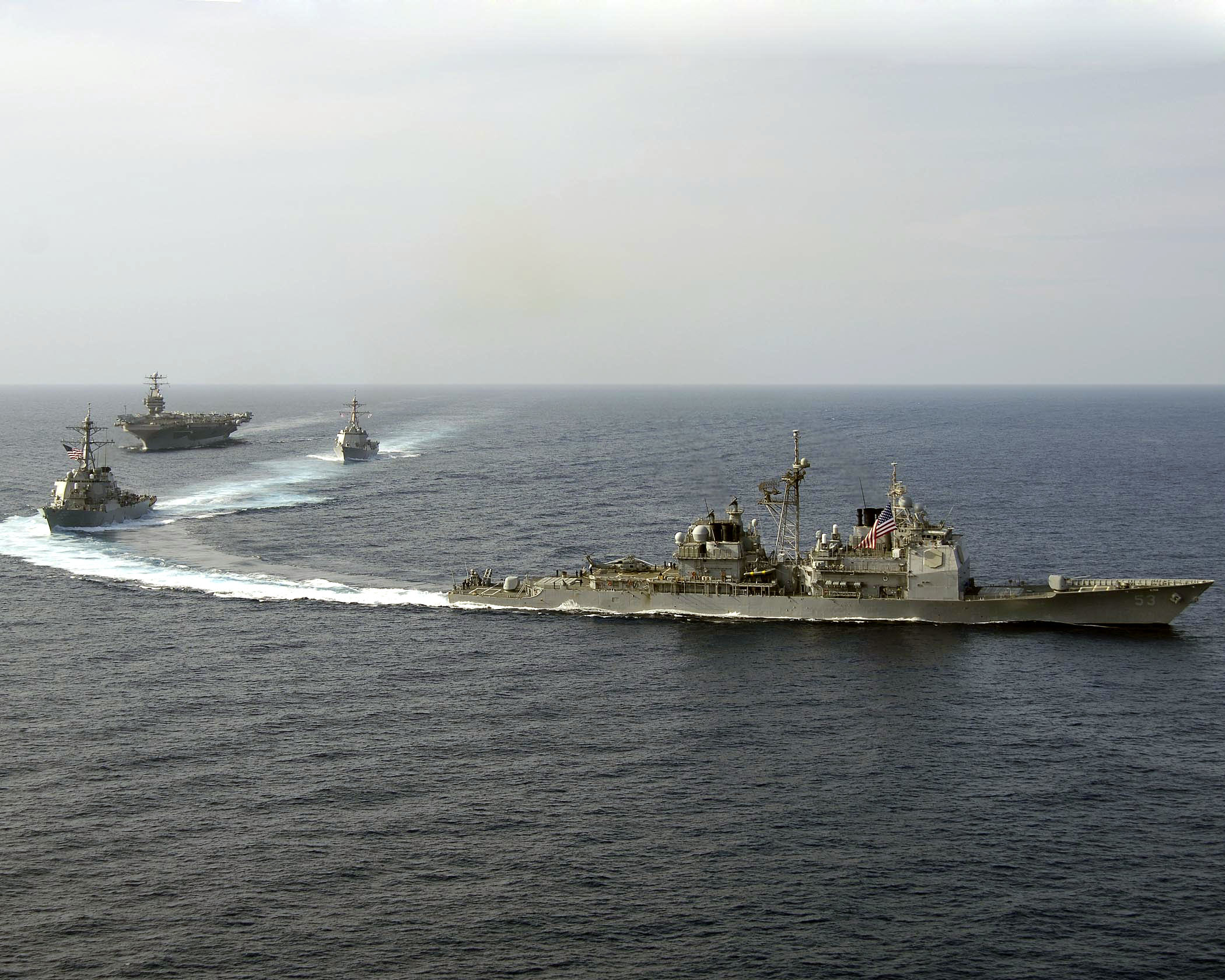 Ddg113 http://commons.wikimedia.org/wiki/File:US_Navy_060416-N-5837R-113_USS_Mobile_Bay_(CG_53),_USS_Russell_(DDG_59),_and_USS_Shoup_(DDG_86)_perform_a_pass_and_review_with_the_Nimitz-class_aircraft_carrier_USS_Abraham_Lincoln_(CVN_72).jpg