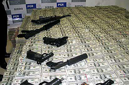 File:Drug Money and weapons seized by the Mexican Police and the DEA 2007.jpg