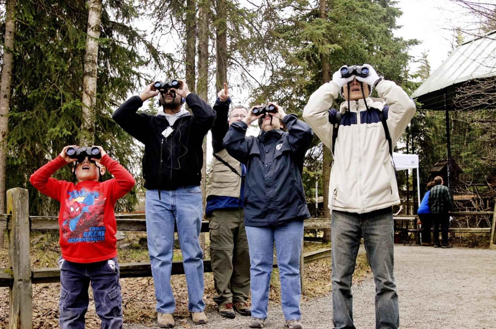 File:Group Of People Look Through Binoculars.jpg