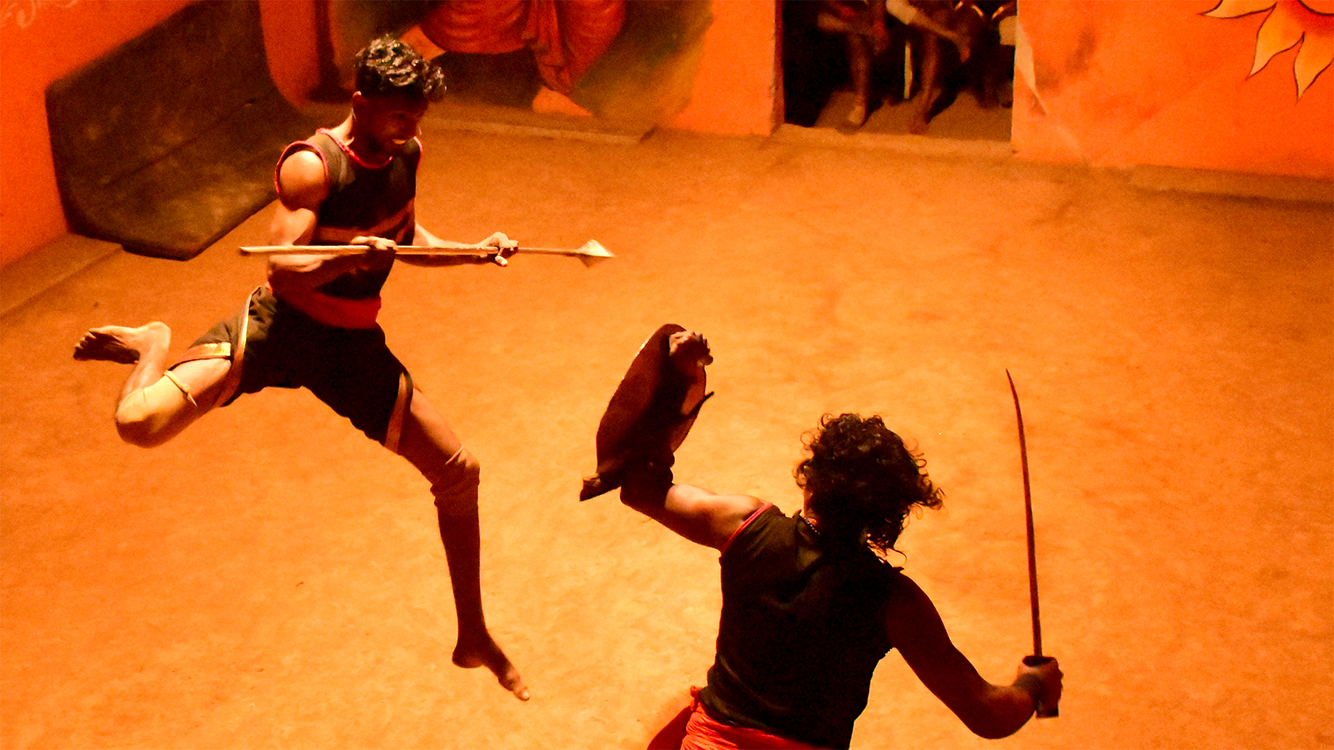 Two guys performing the Kalaripayattu art