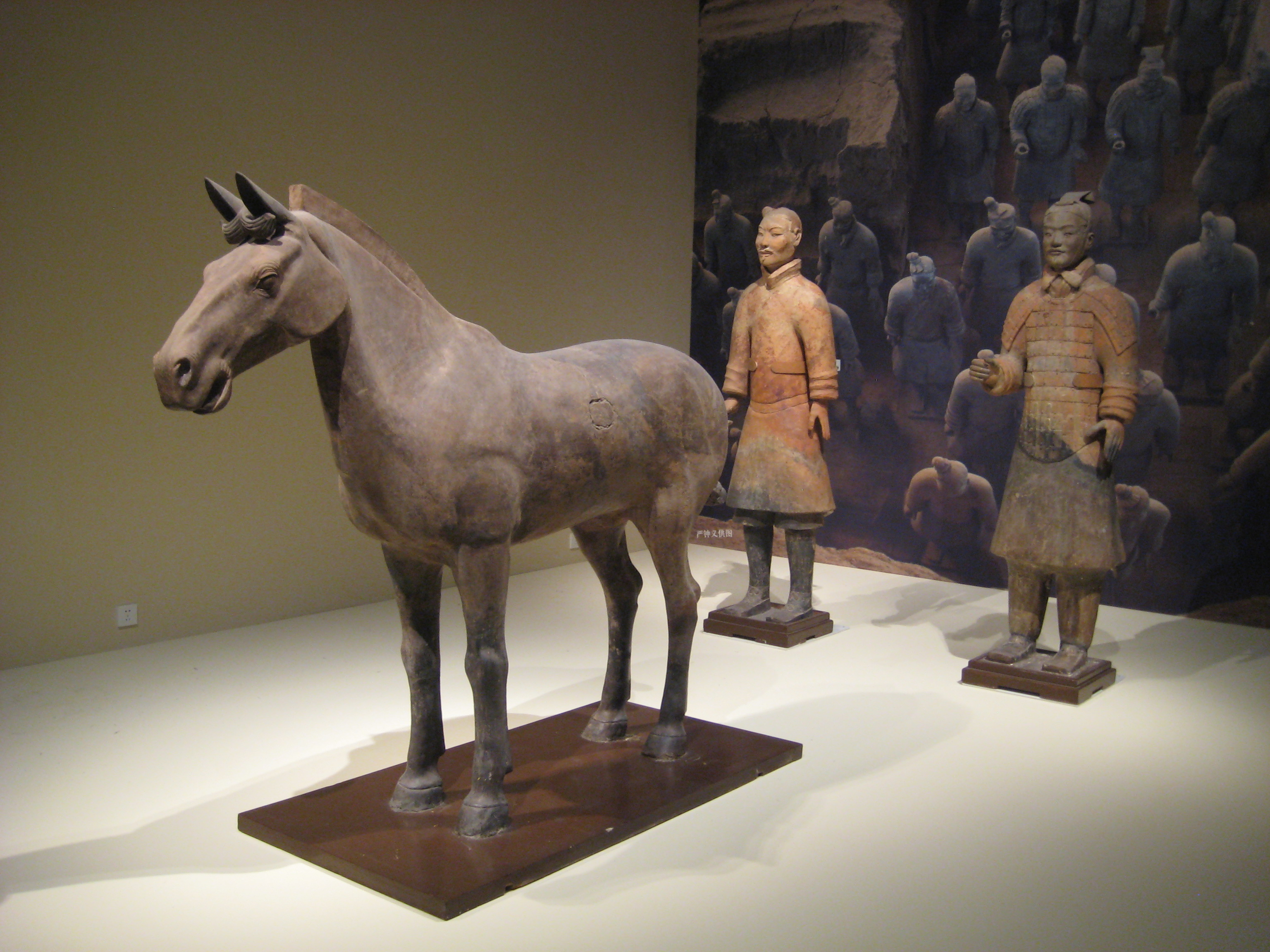 Terracotta horse and two soldiers from the Terracotta Army buried near the Mausoleum of the First Emperor of Qin, at Lintong, Shaanxi Province, 1974