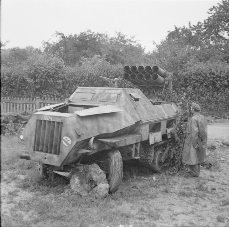 A British soldier examines an abandoned panzerwerfer