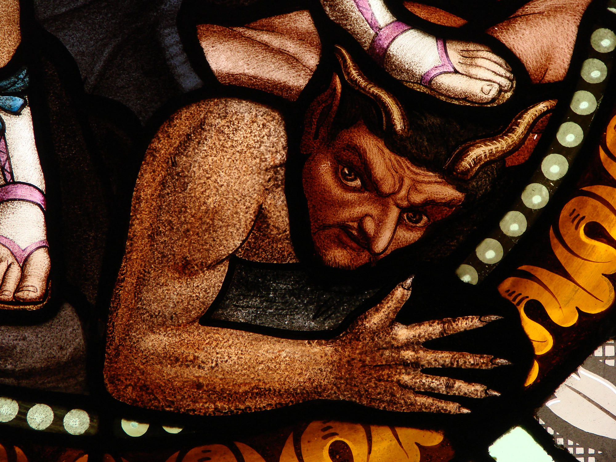 Demon in a Stained Glass Window of Saint-Martin de Florac