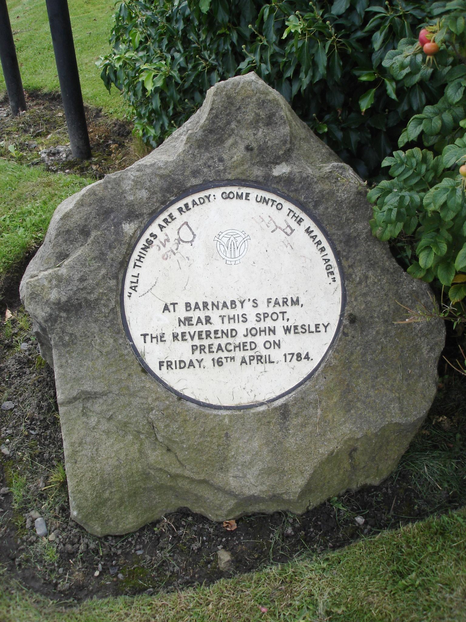 Photo of John Wesley white plaque