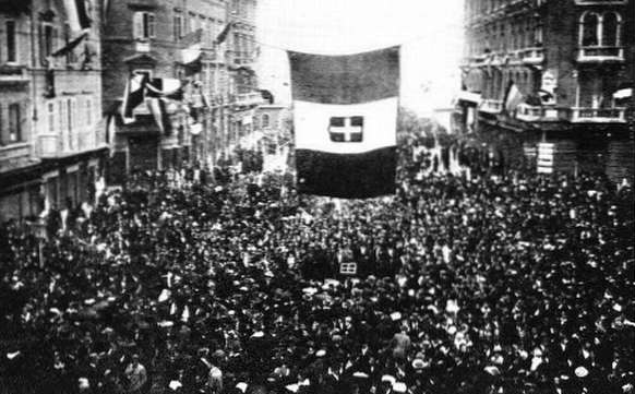 Residents of Fiume cheer the arrival of Gabriele d'Annunzio and his blackshirt-wearing nationalist raiders, as D'Annunzio and Fascist Alceste De Ambris developed the quasi-fascist Italian Regency of Carnaro (a city-state in Fiume) from 1919 to 1920 and whose actions by D'Annunzio in Fiume inspired the Italian Fascist movement Fiume cheering D'Annunzio.jpg