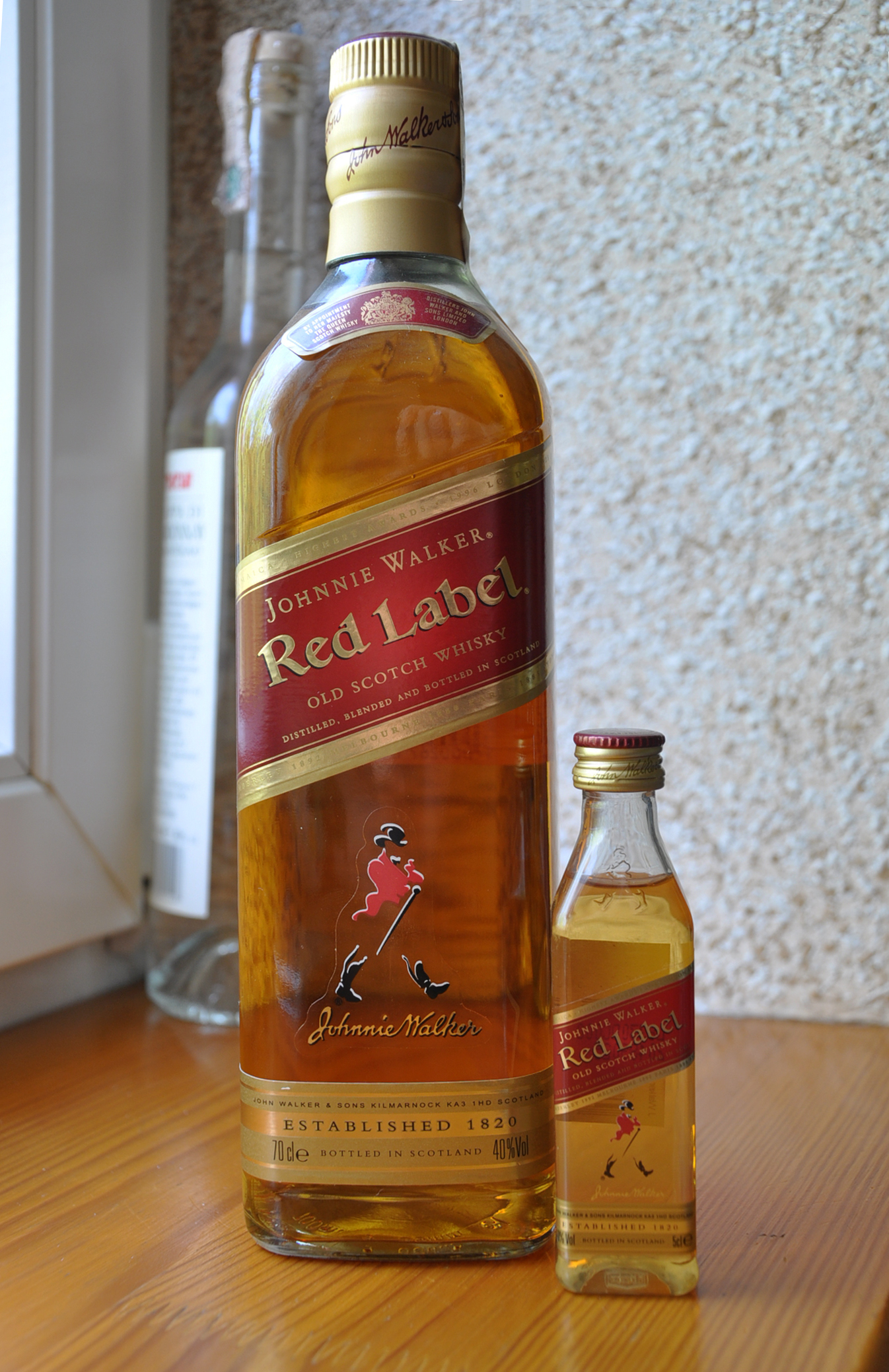 This is an image of Old Fashioned Black Label Red Label Difference