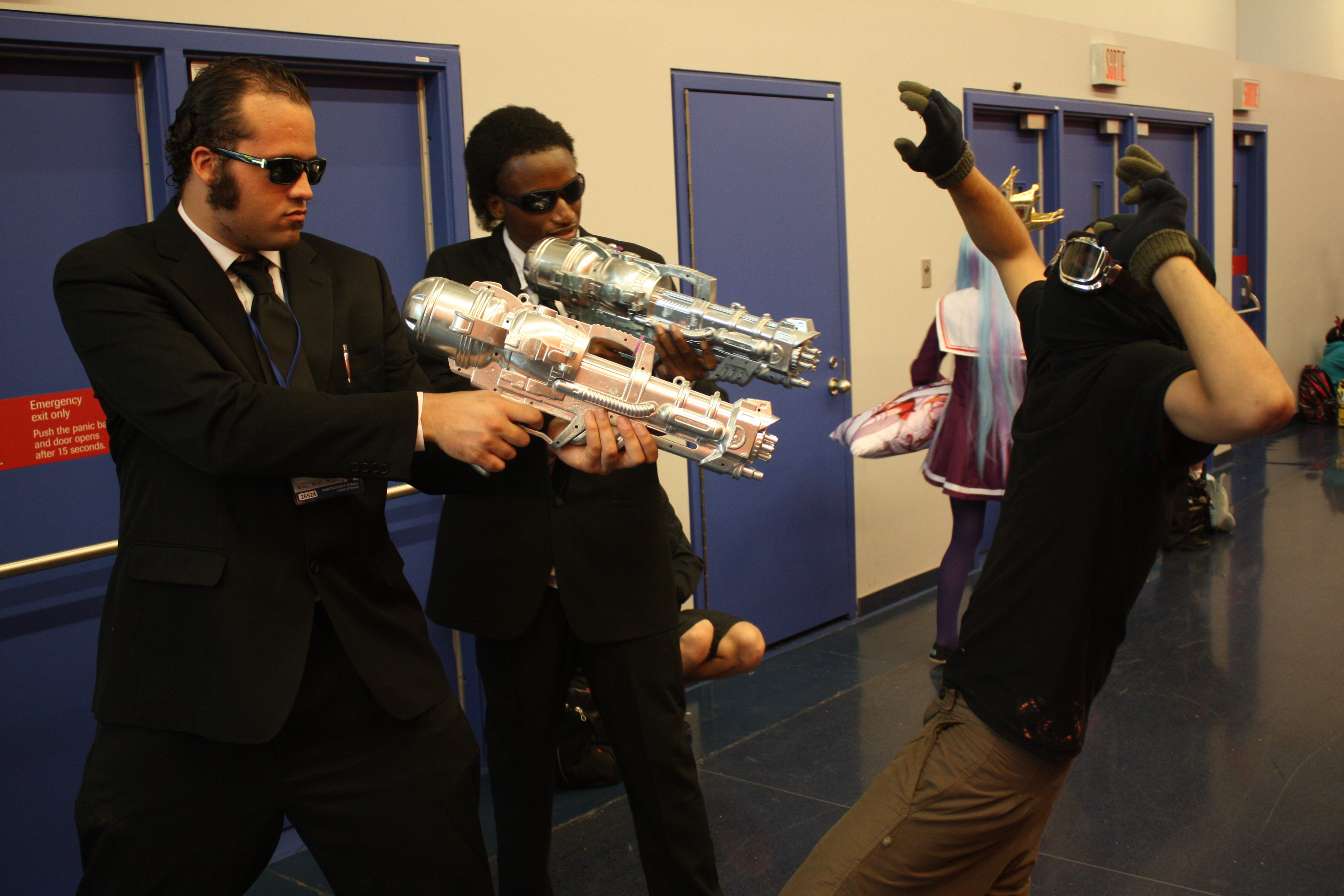 the men in black taking down a thug