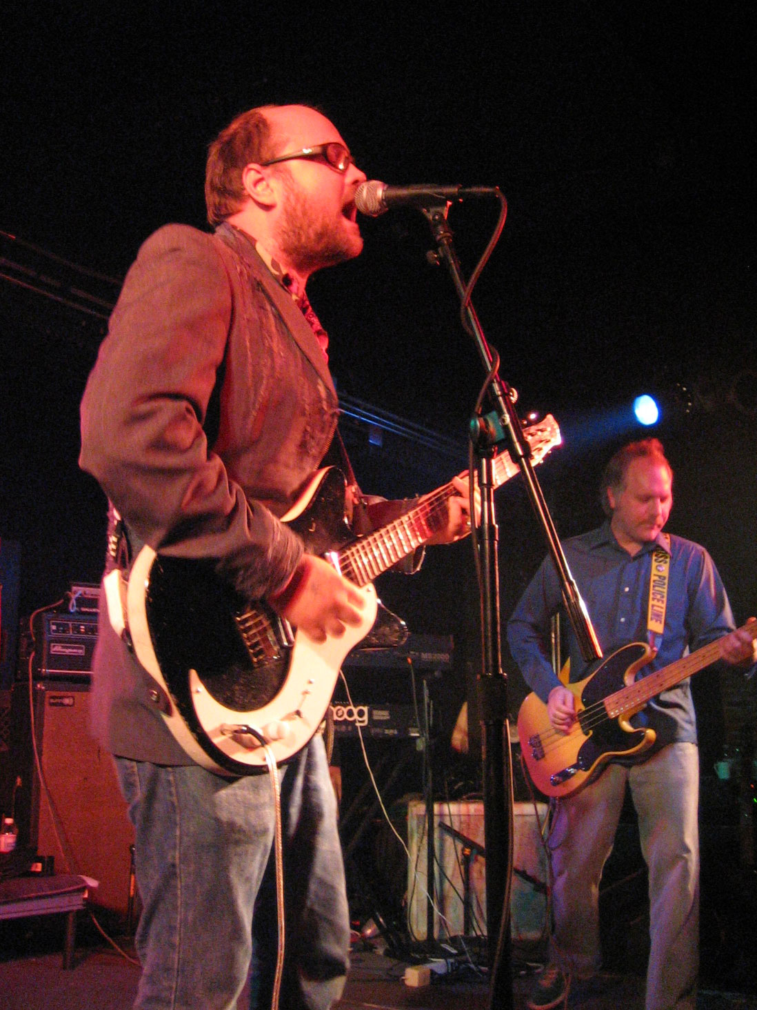 Schneider performing at [[The Black Cat (nightclub)|The Black Cat nightclub]] on October 20, 2006