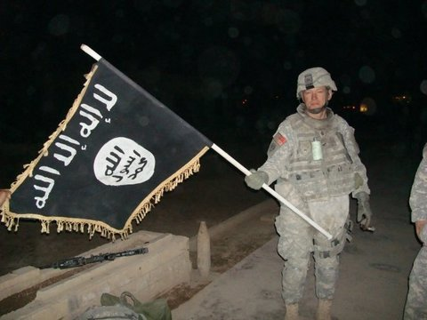 U.S. Army soldier with captured ISIS flag in Iraq, December 2010.jpg